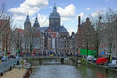 City scenic from Amsterdam in the Netherlands with the Nicolaas church royalty free stock photos
