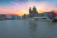 City scenic from Amsterdam in the Netherlands with the Nicolaas church stock images