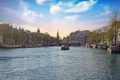 City scenic from Amsterdam in the Netherlands. At the river Amstel with the Munttower at sunset Royalty Free Stock Photo