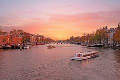City scenic from Amsterdam in the Netherlands. At the river Amstel at twilight Royalty Free Stock Photo