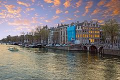 City scenic from Amsterdam in the Netherlands. At the river Amstel at twilight Stock Photography
