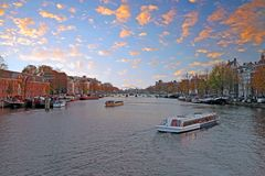 City scenic from Amsterdam in the Netherlands at twilight. City scenic from Amsterdam in the Netherlands at the river Amstel at twilight Royalty Free Stock Image