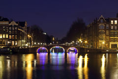 City scenic from Amsterdam by night in Netherlands Stock Photography