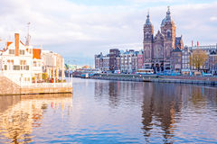 City scenic from Amsterdam with the St. Niklaas church in Ne Stock Images