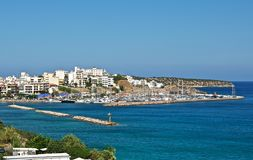 The city by the sea. A small town on the sun-lit beach. In its harbor is a lot of yachts and boats. Today is a good day and they will come out into the sea Stock Photos