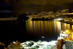 City By The Sea. Night photo of a city by the sea in Madeira Royalty Free Stock Photo