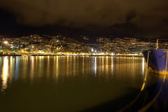 City By The Sea. Night photo of a city by the sea in Funchal Stock Images