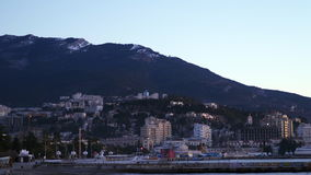 City by the sea on a background of mountains. Early morning. Yalta, Crimea - December 23, 2016: City by the sea on a background of mountains. Early morning stock video