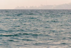City on the sea coast. In the distance on the sea horizon, you can see the city Royalty Free Stock Photography