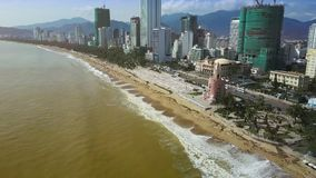 City Seafront with Ocean Drive Hotels Foamy Waves Panorama. Amazing panorama resort city seafront with hotel buildings on Yellow sea shore and beach after stock footage