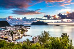 City Seascape with Aerial View of Alesund Center, Islands and Atlantic Ocean at Gorgeous Sunset stock photo