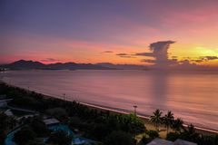 City Seascape with Aerial View of Nha Trang Beach, Mountains and Bay at Breaking Dawn royalty free stock images