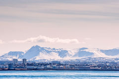 City seascape of Reykjavik with mountains in the background Stock Photos