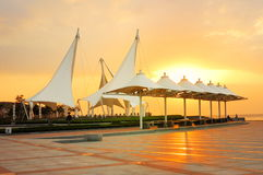 City seashore public square lying fallow. A slice that the setting sun illuminates down are aureate Royalty Free Stock Images