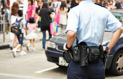 City security. policeman in the street. City security. policeman watching order in the urban street Stock Photography