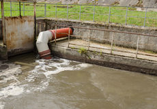 City sewage waste water and garbage flow pipe tube Royalty Free Stock Photography