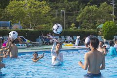 14.08.2018.The city of Shima is the Hotel Daiwa Royal Hotel. People play ball in the pool.Pool stock photography