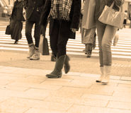 City shopping abstract. People legs walking in a city-sepia colors tones Royalty Free Stock Image