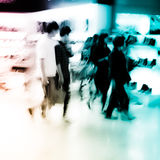 City shopping people crowd at marketplace. Shoe shop abstract background Royalty Free Stock Photo