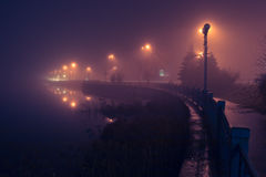 City shore in fog. Stock Photography