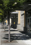 City Sidewalks 1. A sidewalk alongside a strip mall in Bellevue, Washington Stock Photography