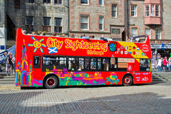 City sightseeing bus in Edinburgh. Colorful open top sightseeing bus in the Scottish city of Edinburgh Royalty Free Stock Images