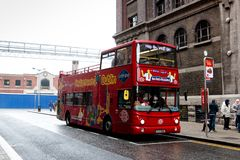 City Sightseeing Dublin famous double deck tour buses, which go around the city and stop at points of interests where people can h. April 12th, 2018, Dublin Royalty Free Stock Photos