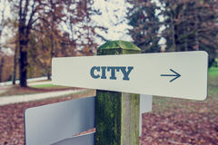 City signpost with right pointing arrow Stock Image
