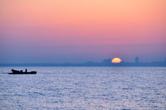 City silhouette. From sea at sunrise Royalty Free Stock Photography