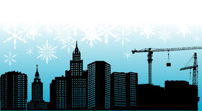 City silhouette and snowflakes Stock Photos
