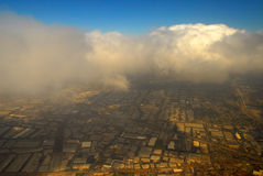 City in the sky. Flying over Los Angeles and maze of city streets Stock Images