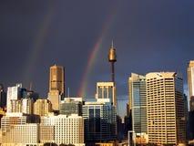 City Skyline - with 2 rainbows!. Urban skyline with 2 rainbows in a dark sky Stock Photos
