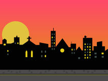 City skyline. A city skyline thrown into silhouette by the setting sun Stock Photography