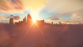 City skyline above clouds, timelapse sunrise stock footage