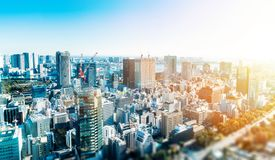 City skyline aerial view in tokyo, japan with miniature lens tilt shift blur effect. Business and culture concept - panoramic modern city skyline bird eye aerial stock photos