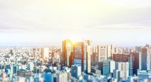 City skyline aerial view in tokyo, japan with miniature lens tilt shift blur effect. Business and culture concept - panoramic modern city skyline bird eye aerial royalty free stock images