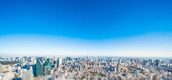 City skyline aerial view in tokyo, japan with miniature lens tilt shift blur effect. Business and culture concept - panoramic modern city skyline bird eye aerial stock photography