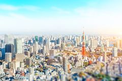 City skyline aerial view in tokyo, japan with miniature lens tilt shift blur effect. Business and culture concept - panoramic modern city skyline bird eye aerial royalty free stock photos