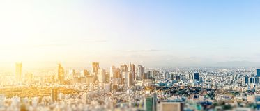 City skyline aerial view in tokyo, japan with miniature lens tilt shift blur effect. Business and culture concept - panoramic modern city skyline bird eye aerial stock photo