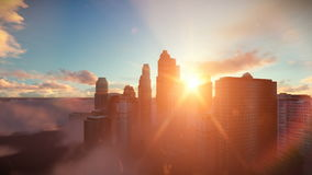 City skyline against sunset, flight over clouds, dolly shot royalty free illustration