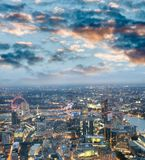 City skyline along river Thames at night, aerial view - London -. UK Royalty Free Stock Photo
