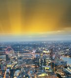City skyline along river Thames at night, aerial view - London -. UK Stock Image