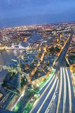 City skyline along river Thames with at night with London Bridge. Train station, aerial view - London - UK Stock Image