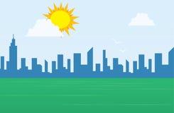 City Skyline behind grass. Daytime city skyline with large sun above a grassy field Royalty Free Stock Photo