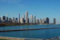 A city skyline with a blue lake and a blue sky Royalty Free Stock Photo