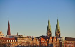 City skyline of Bremen, Germany in the evening light with the spires of St. Peter`s Cathedral and the Church of our Lady. City skyline of Bremen, Germany in the Royalty Free Stock Image