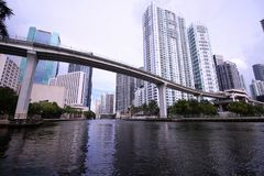 City Skyline of Brickell and Downtown Miami with the Metro Mover Rail Bridge over the River stock photo