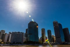 City skyline with buildings in Australia, Melbourne. The view of a sunbeam with rays and blue sky in the day royalty free stock image