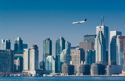 City skyline with a business jet above  Royalty Free Stock Image