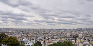 The city skyline at daytime. Paris, France. Panoramic view on roof of houses Royalty Free Stock Photos